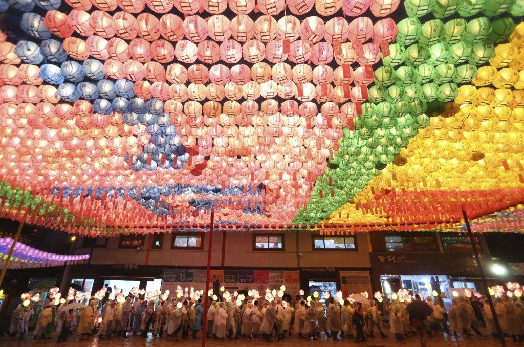 In this Saturday, May 12, 2018, file photo, Buddhists carry lanterns in a parade during the Lotus Lantern Festival to celebrate the upcoming birthday