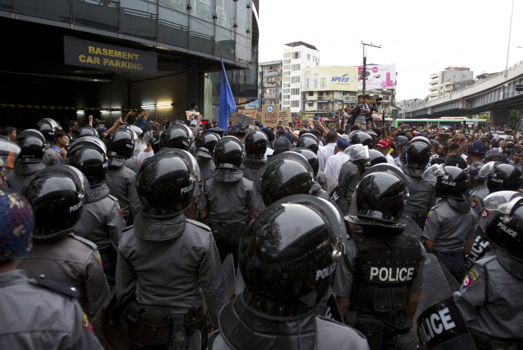 In this Saturday, May 12, 2018, file photo, riot polices stand in position to block activists during a peace rally, Yangon, Myanmar. Myanmar police ha