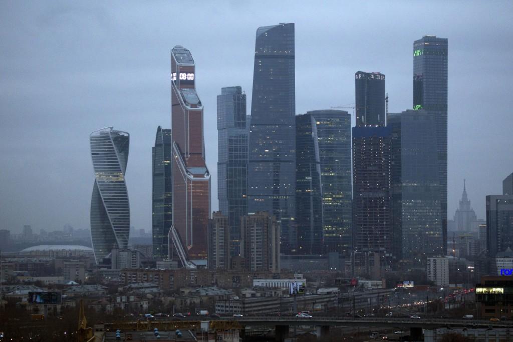 In this photo taken on Friday, Nov. 10, 2017, Moscow City skyscrapers, center, the Luzhniki stadium, left, and the Lomonosov Moscow State University, ...