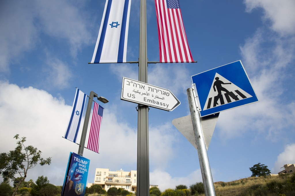 A road sign leading to the U.S. Embassy is seen ahead the official opening in Jerusalem, Sunday, May 13, 2018. Monday's opening of the U.S. Embassy in...