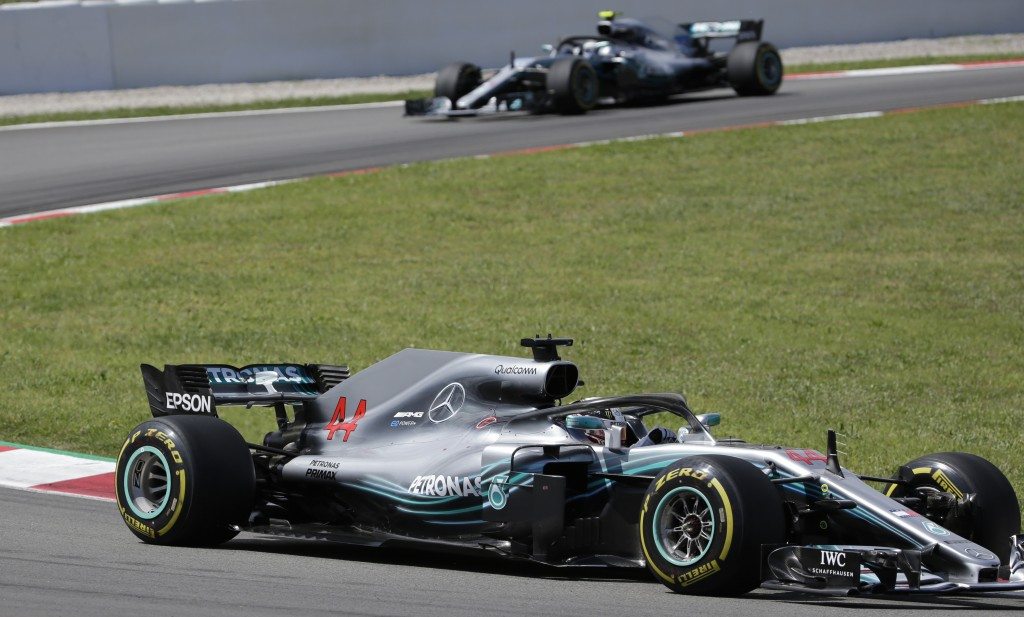 Mercedes driver Lewis Hamilton of Britain leads his teammate Mercedes driver Valtteri Bottas of Finland during the Spanish Formula One Grand Prix at t