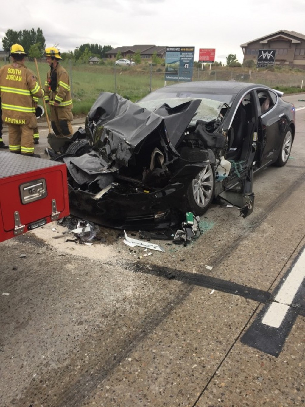 In this Friday, May 11, 2018, photo released by the South Jordan Police Department shows a traffic collision involving a Tesla Model S sedan with a Fi
