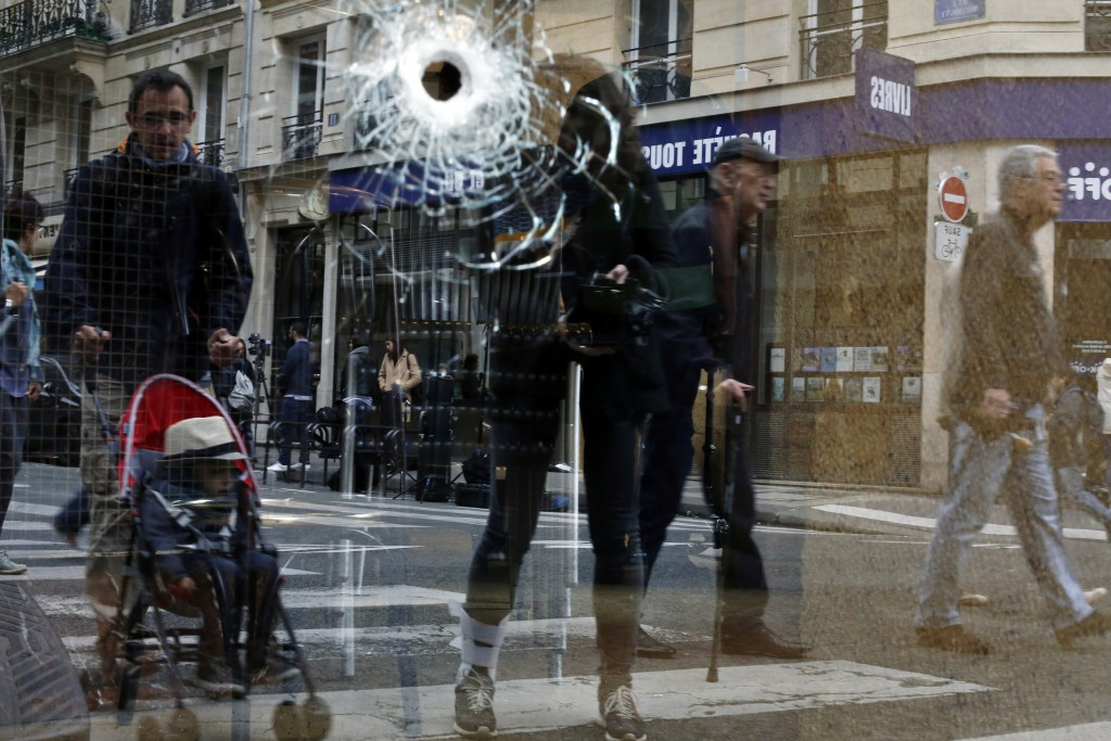 A bullet hole seen on the window of a cafe located near the area where the assailant of a knife attack was shot dead by police officers, in central Pa...
