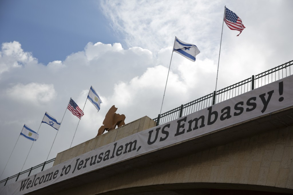 A sign on a bridge leading to the US Embassy compound ahead the official opening in Jerusalem, Sunday, May 13, 2018. Monday's opening of the U.S. Emba...