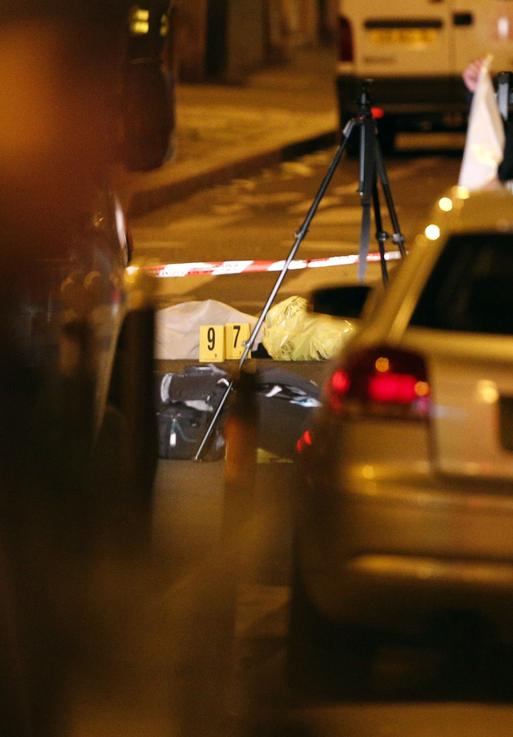 A dead body lays under a blanket after a knife attack Saturday that left at least two dead including the assailant in central Paris, early Sunday May ...