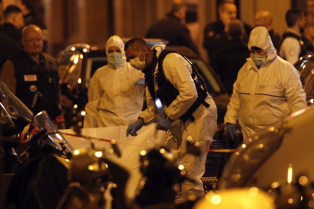 Scientific police officers investigate after a knife attack in central Paris, Saturday May 12, 2018. A knife-wielding assailant killed at least one pe...