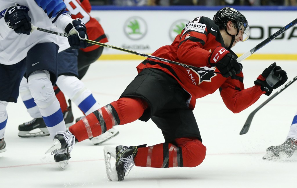 Finland's Miro Heiskanen, left, checks Canada's Ryan Nugent-Hopkins, right, during the Ice Hockey World Championships group B match between Canada and...