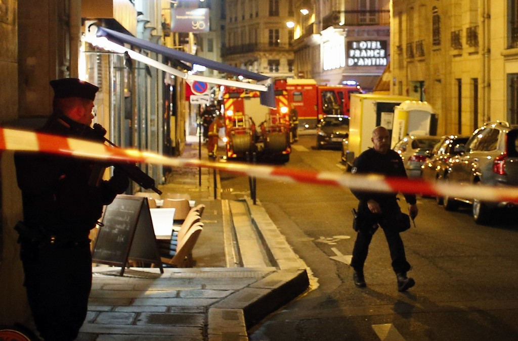 Police officers cordon off the area after a knife attack in central Paris, Saturday May 12, 2018. The Paris police said the attacker was subdued by of...