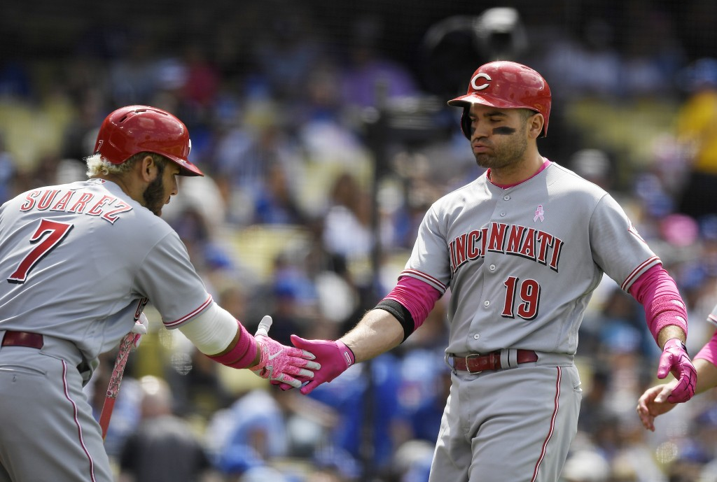Cincinnati Reds' Joey Votto, right, is congratulated by Eugenio Suarez after hitting a two-run home run during the sixth inning of a baseball game aga