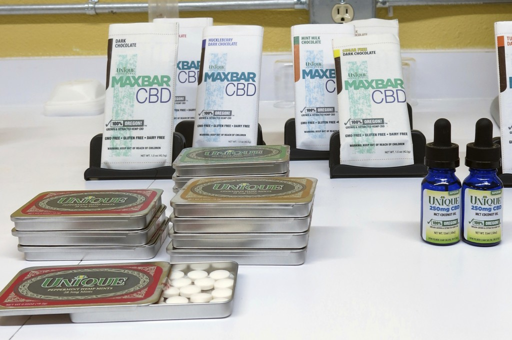 In this April 16, 2018 photo, products containing cannabidiol, or CBD, are on display at Unique Food Works, a state-licensed hemp handling facility in...