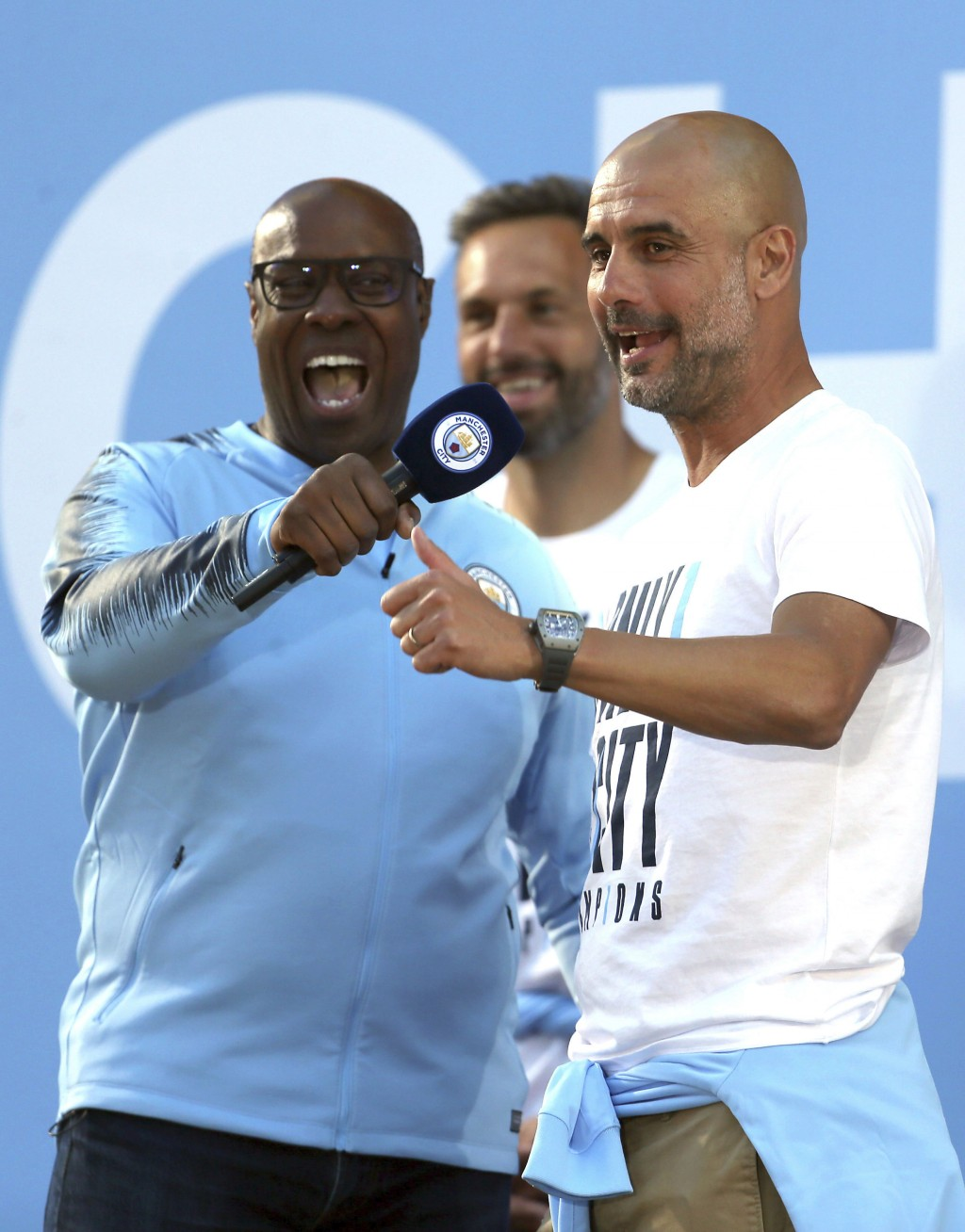 Manchester City soccer team manager Pep Guardiola, right, acknowledges supporters during the British Premier League champions trophy parade in Manches