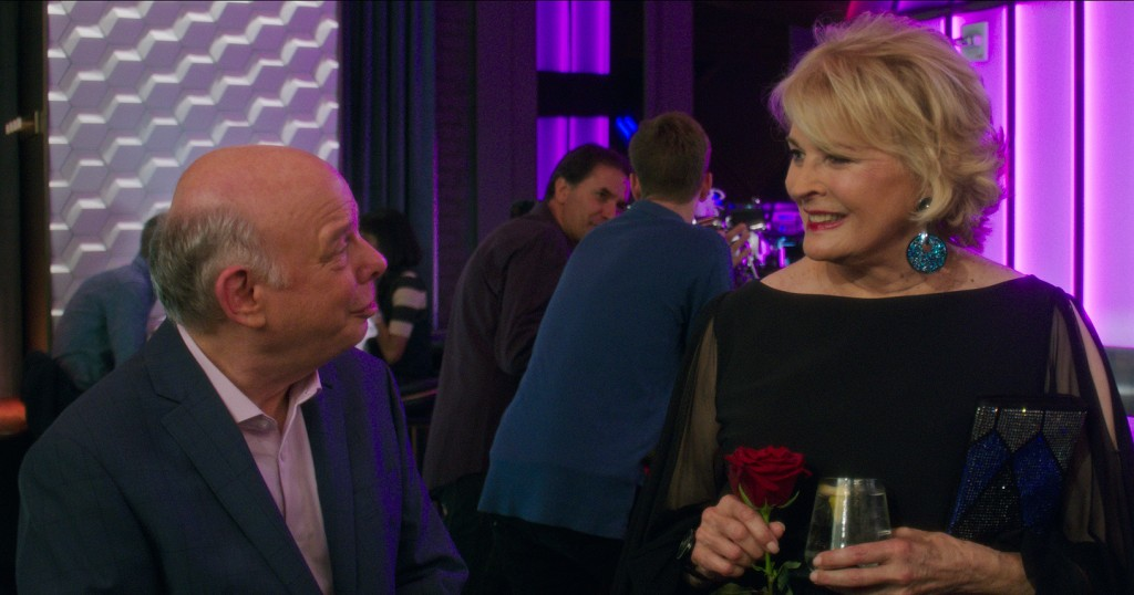 """This image released by Paramount Pictures shows Wallace Shawn, left, and Candice Bergen in a scene from """"Book Club."""" (Paramount Pictures via AP)"""