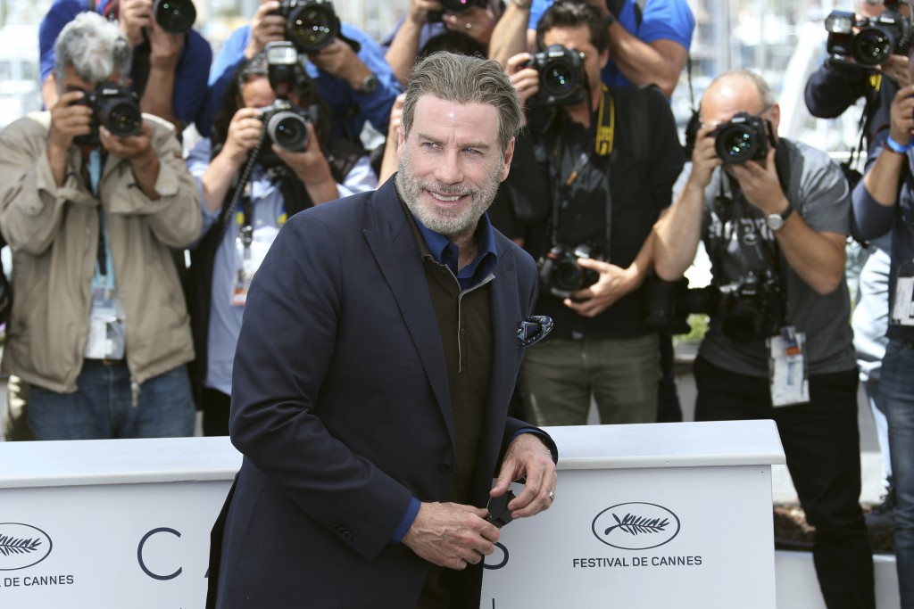 Actor John Travolta poses for photographers during a photo call for the film 'Gotti' at the 71st international film festival, Cannes, southern France,