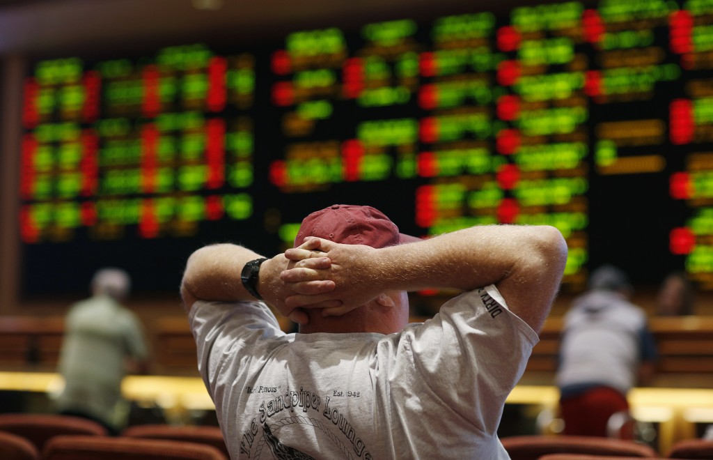 A man watches a baseball game in the sports book at the South Point hotel-casino, Monday, May 14, 2018, in Las Vegas. The Supreme Court on Monday gave
