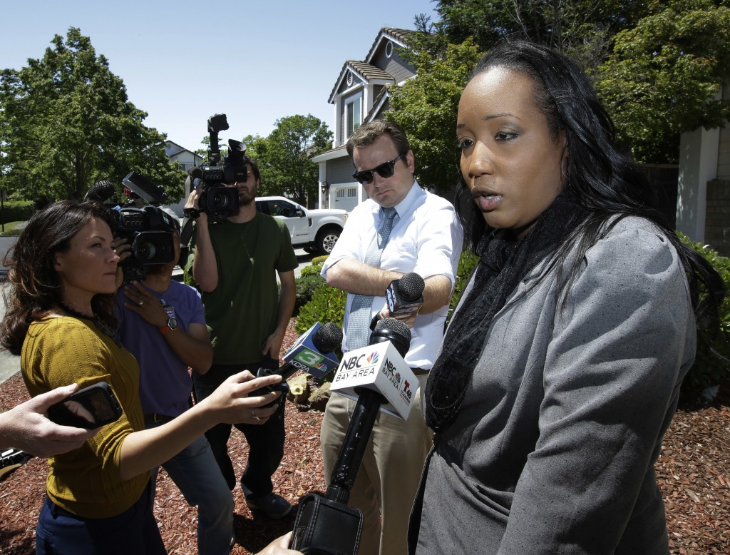 Ina Rogers talks with reporters about the seizure of her 10 children by law enforcement Monday, May 14, 2018, in Fairfield, Calif. Authorities removed