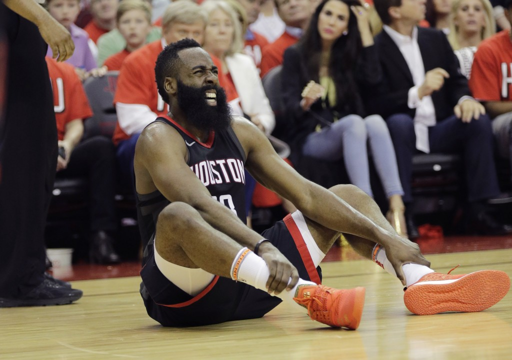 Houston Rockets guard James Harden reacts after he was injured during the first half of Game 1 of the NBA basketball Western Conference Finals against