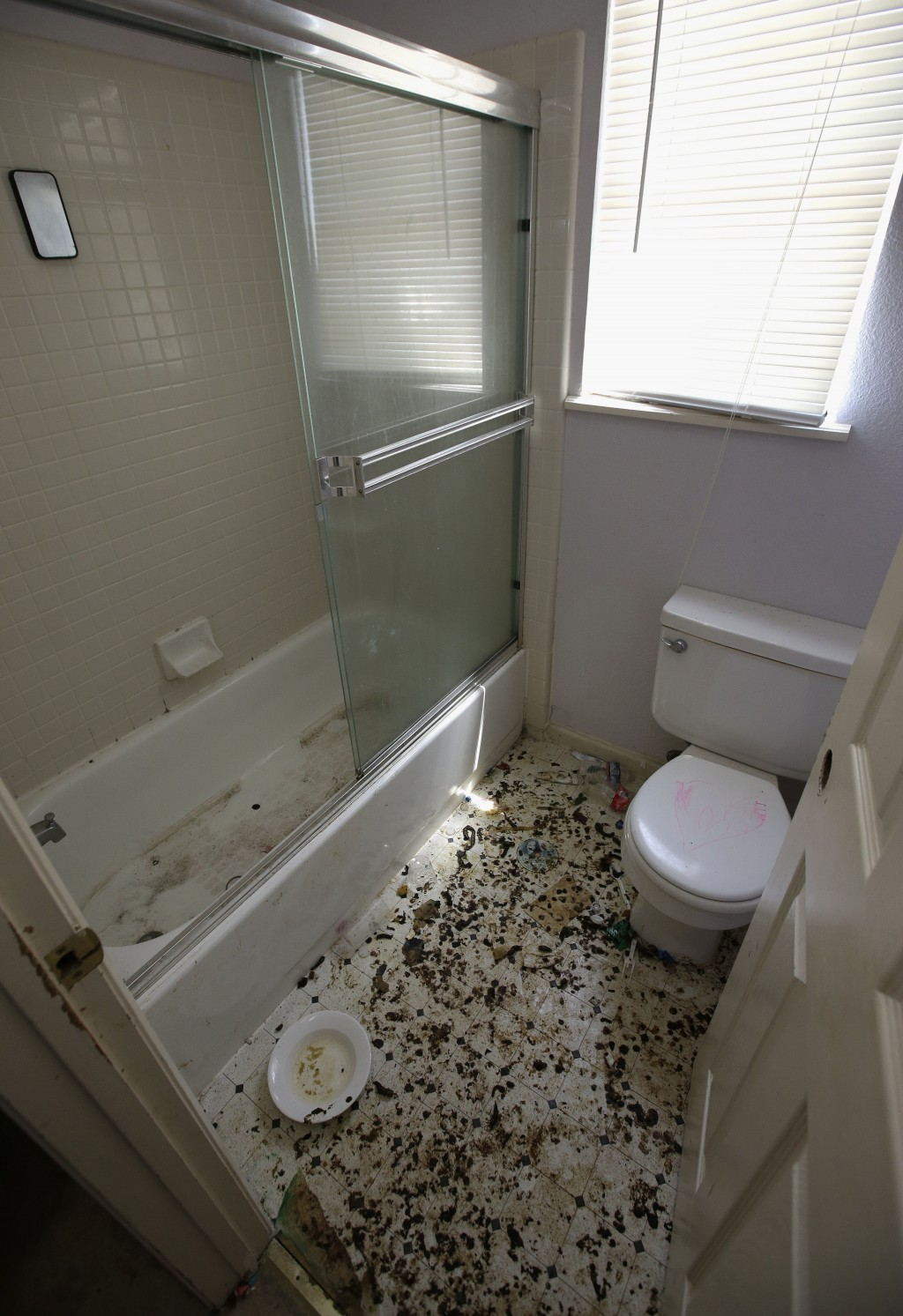 The bathroom is strewn with feces at a home in Fairfield, Calif., Monday, May 14, 2018, where authorities removed 10 children and charged their father