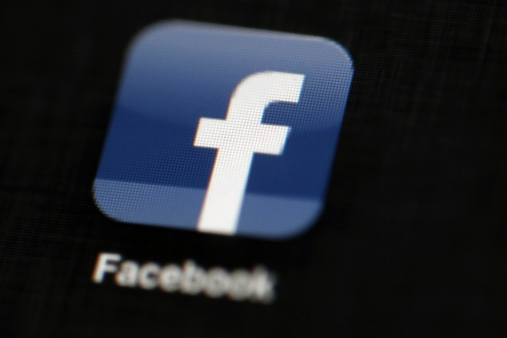 FILE - In this May 16, 2012, file photo, the Facebook logo is displayed on an iPad in Philadelphia.  Facebook believes its policing system is better a...