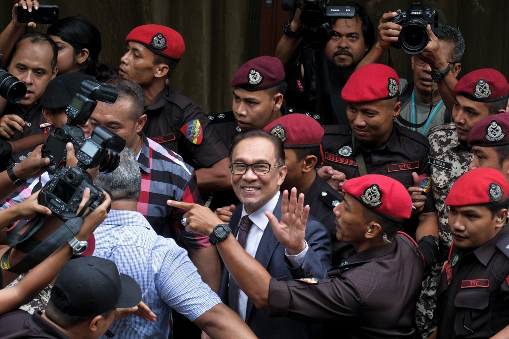 In this Wednesday, May 16, 2018, file photo, Malaysia's reformist icon Anwar Ibrahim arrives at his house in Kuala Lumpur, Malaysia. Malaysia's reform
