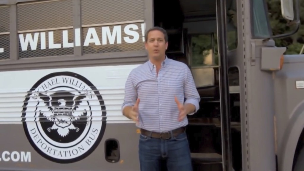 "In this frame from video provided by the Michael Williams for Governor campaign, Williams shows off his ""Deportation Bus"" in an advertisement. News ou"