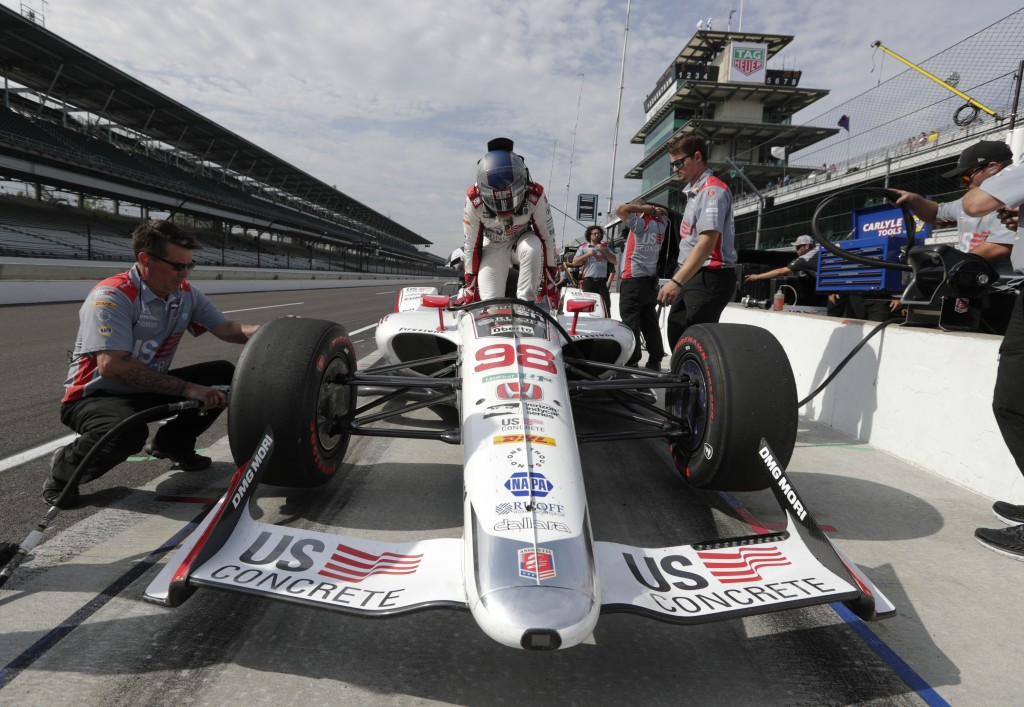 Marco Andretti climbs into his car during practice fort the IndyCar Indianapolis 500 auto race at Indianapolis Motor Speedway, in Indianapolis Tuesday