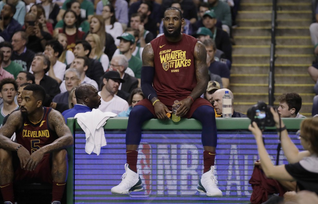 Cleveland Cavaliers forward LeBron James sits on the scorer's table during a timeout in the first half in Game 2 of the team's NBA basketball Eastern