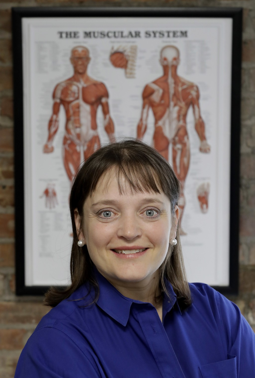 In this Saturday, May 12, 2018, photo, April Oury, owner of Body Gears physical therapy center poses for a portrait at on of her centers in Chicago. O