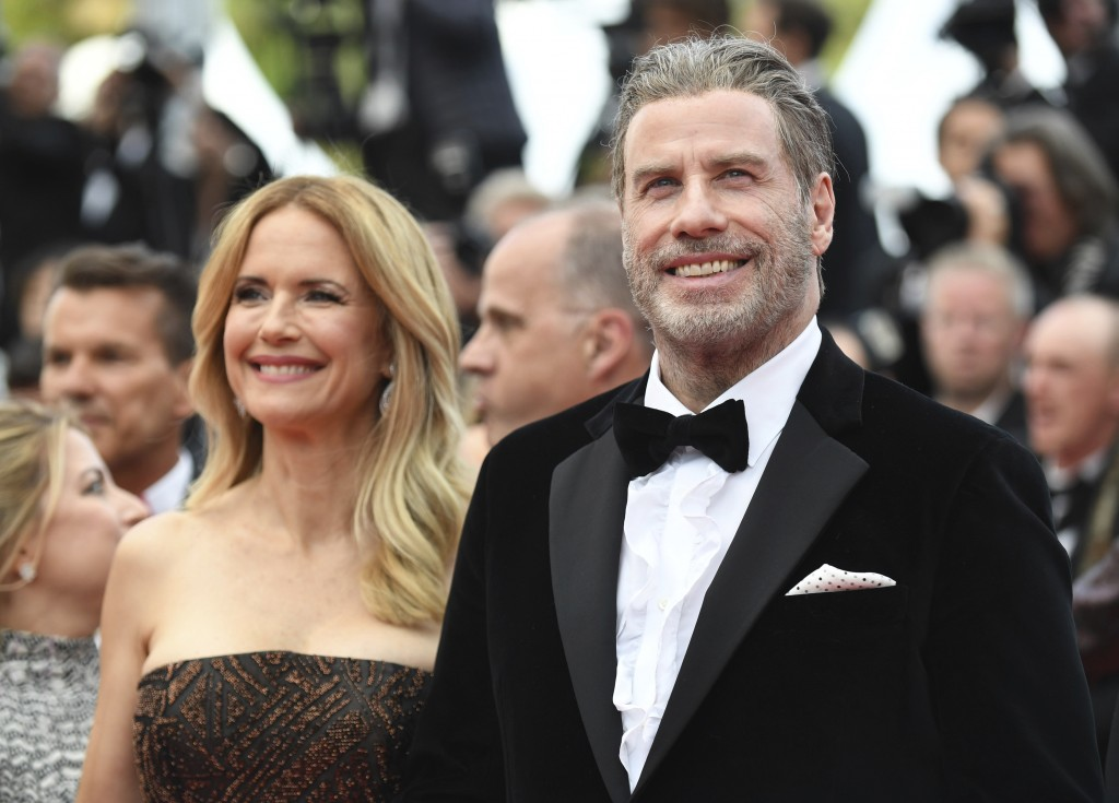 Actors Kelly Preston, left, and John Travolta from the film 'Gotti' pose for photographers upon arrival at the premiere of the film 'Solo: A Star Wars