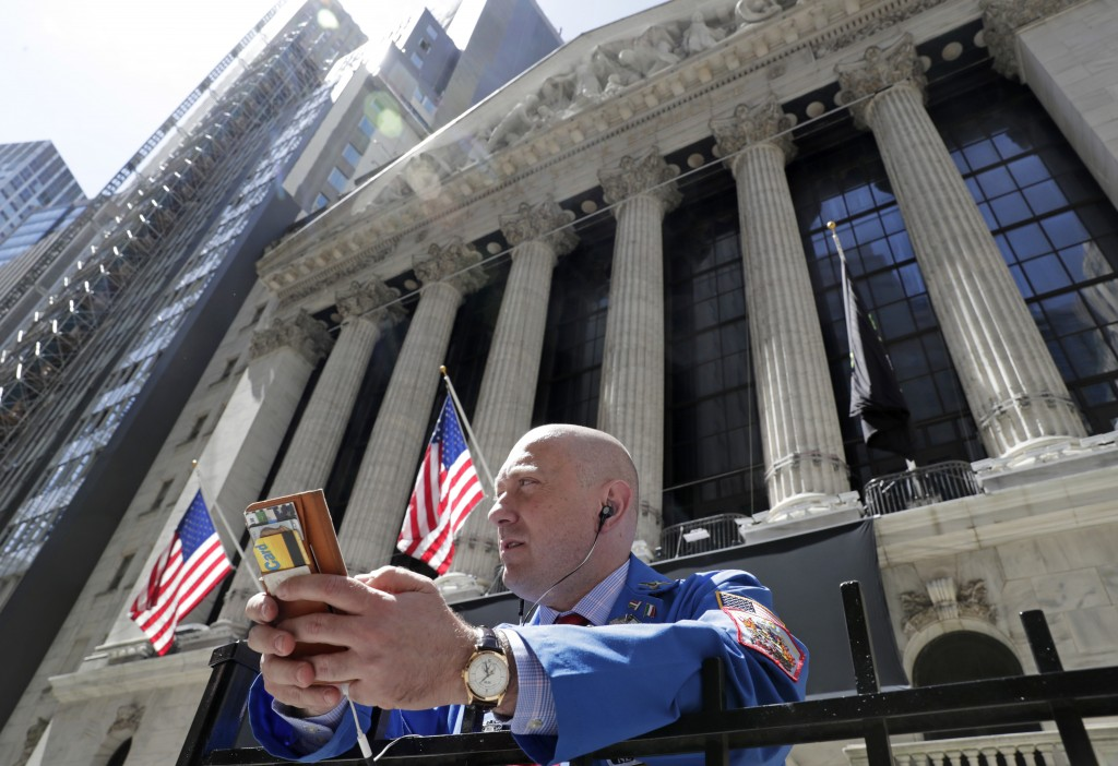 FILE- In this April 26, 2018, file photo, Vincent Pepe enjoys some fresh air outside the New York Stock Exchange where he works in the Financial Distr