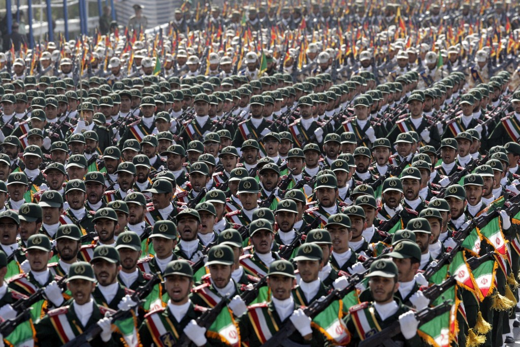 FILE - In this Sept. 21, 2012 file photo, Iran's Revolutionary Guard troops march during a military parade commemorating the start of the Iraq-Iran wa