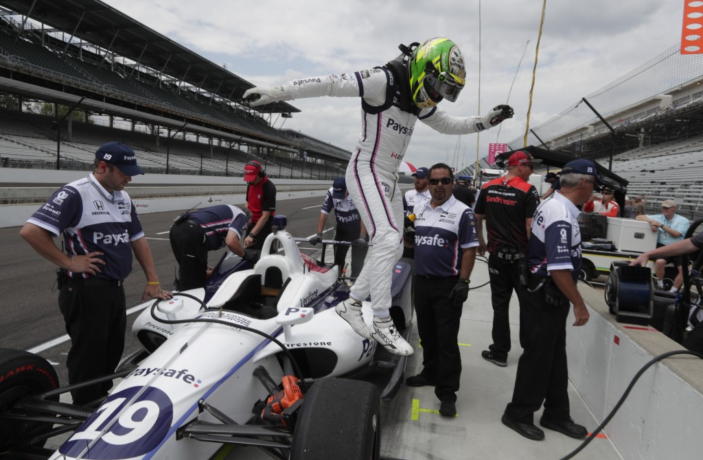 Zachery Claman DeMelo, of Canada, leaps from his car after driving during practice for the IndyCar Indianapolis 500 auto race at Indianapolis Motor Sp