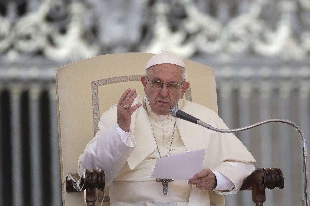 Pope Francis reads his message during his weekly general audience in St. Peter's Square at the Vatican, Wednesday, May 16, 2018. Pope Francis warned W