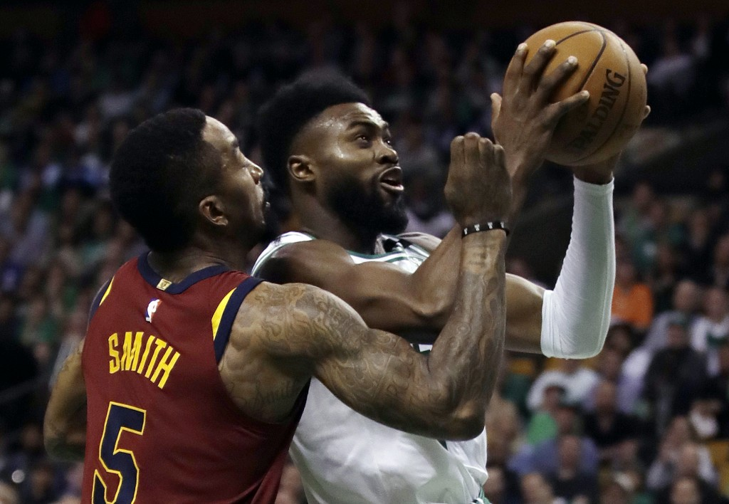 Boston Celtics guard Jaylen Brown, right, tries to drive against Cleveland Cavaliers guard JR Smith (5) during the second half in Game 2 of the NBA ba