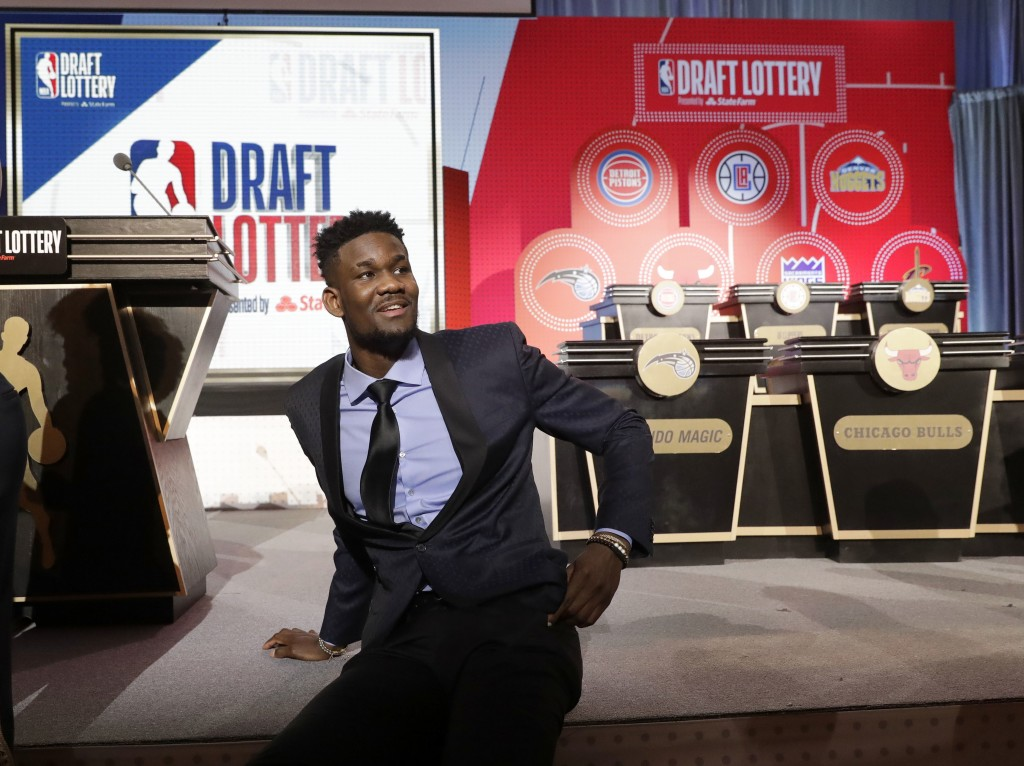 DeAndre Ayton from Arizona sits on the stage before the NBA basketball draft lottery Tuesday, May 15, 2018, in Chicago. (AP Photo/Charles Rex Arbogast