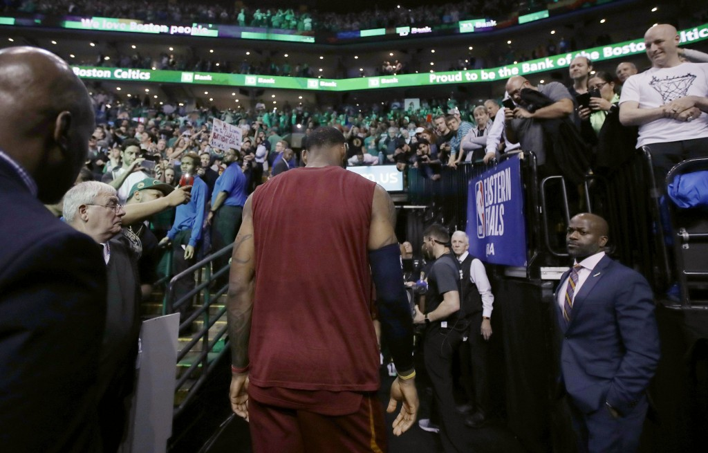 Cleveland Cavaliers forward LeBron James heads off the court after the team's 107-94 loss to the Boston Celtics in Game 2 of the NBA basketball Easter