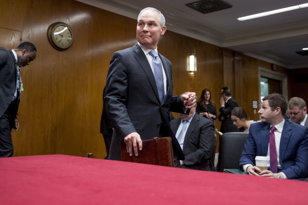 Environmental Protection Agency Administrator Scott Pruitt, accompanied by a member of his security, left, arrives to testify before a Senate Appropri