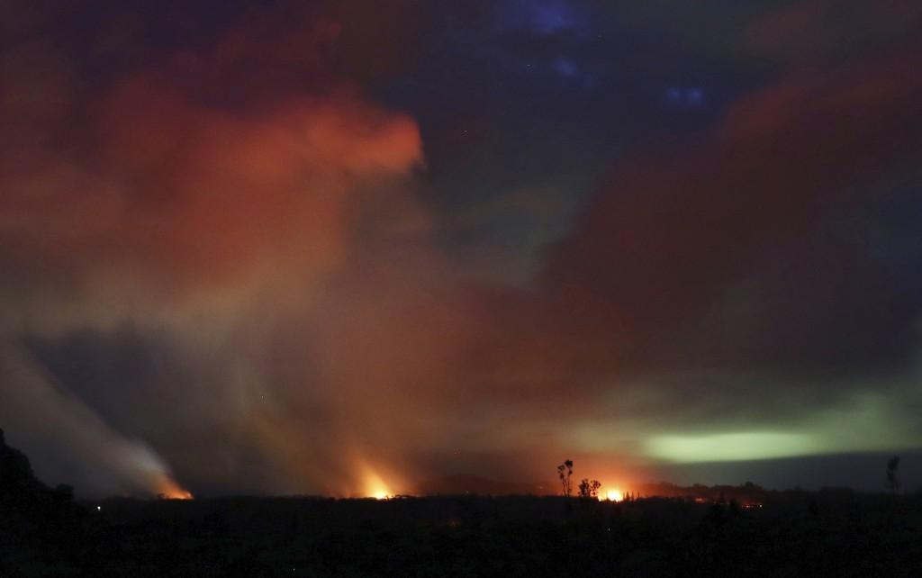 Lava shoots into the night sky from active fissures on the lower east rift of the Kilauea volcano, Tuesday, May 15, 2018 near Pahoa, Hawaii. (AP Photo...
