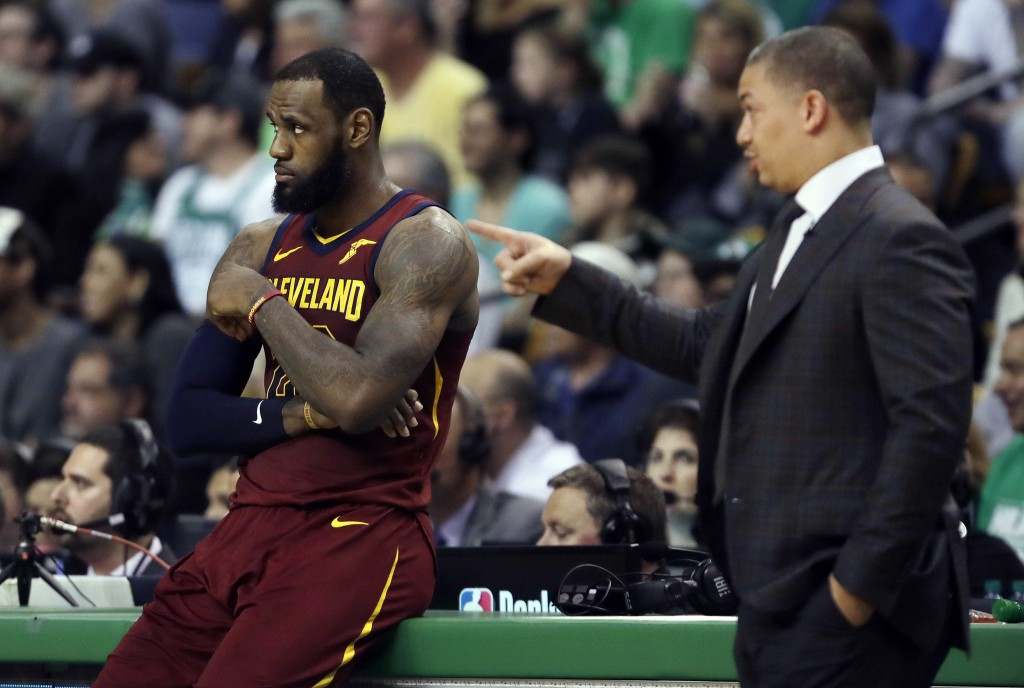 Cleveland Cavaliers coach Tyronn Lue, right, speaks to LeBron James during a timeout in the first half in Game 2 of the  team's NBA basketball Eastern