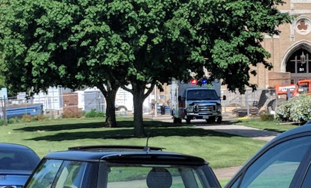 An emergency vehicle appears outside Dixon High School Wednesday, May 16, 2018 in Dixon, Ill. Officials say a police officer has shot and wounded a gu