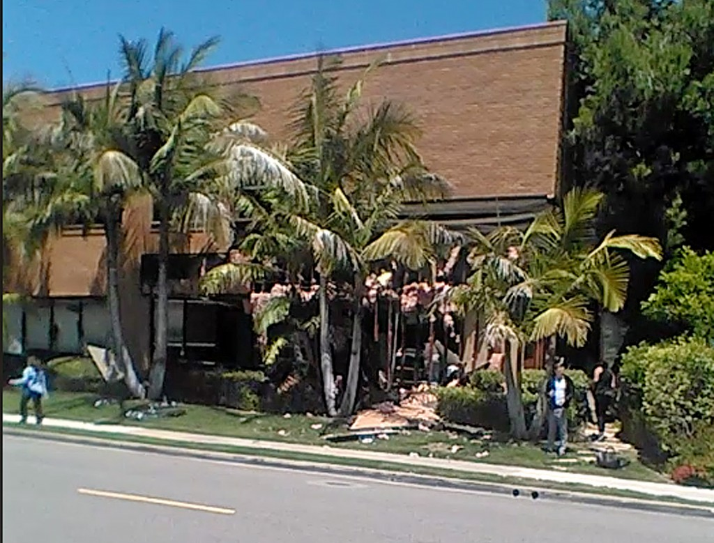 This image taken from cellphone video shows a building after a fatal explosion in Aliso Viejo, Calif., Tuesday, May 15, 2018. The cause of the blast i