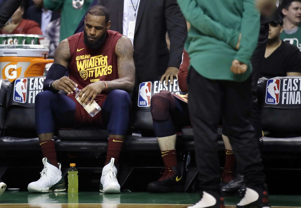 Cleveland Cavaliers forward LeBron James sits on the bench during a timeout in the second half in Game 2 of the team's NBA basketball Eastern Conferen