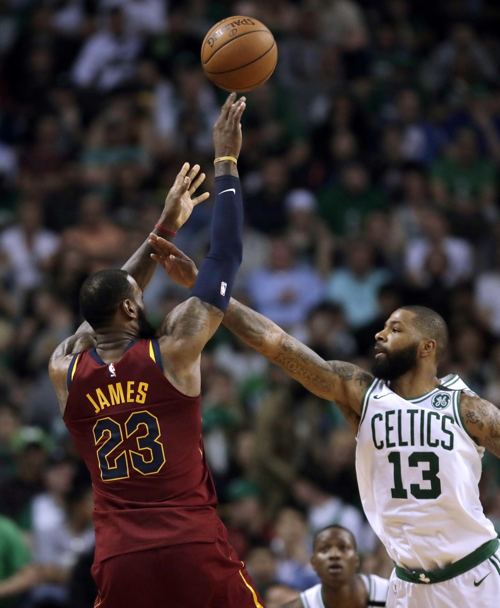 Cleveland Cavaliers forward LeBron James, left, shoots over Boston Celtics forward Marcus Morris during the second half in Game 2 of the NBA basketbal
