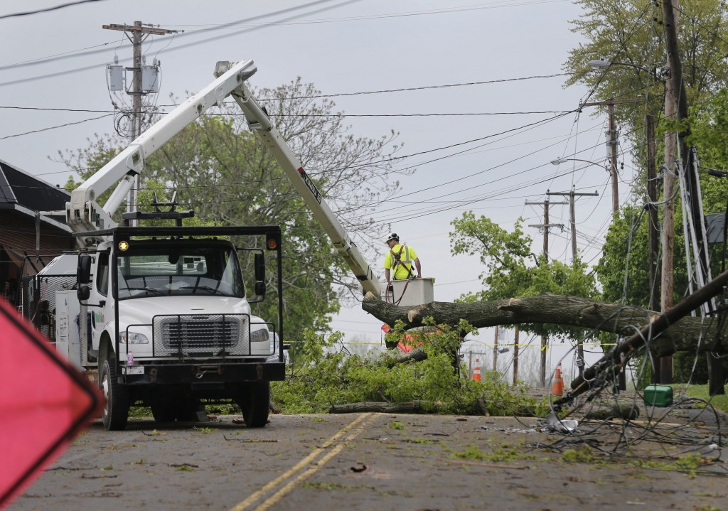A utility crew works to clear a roadway of storm debris in Newburgh, N.Y., Wednesday, May 16, 2018. Powerful storms pounded the Northeast on Tuesday w