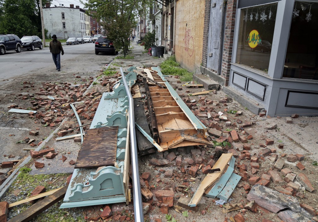 Debris from a storm-damaged building lies in the street in Newburgh, N.Y., Wednesday, May 16, 2018. Powerful storms pounded the Northeast on Tuesday w