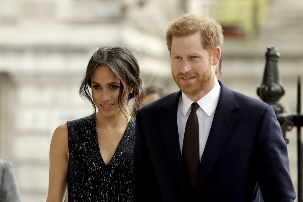 FILE - In this Monday, April 23, 2018 file photo, Britain's Prince Harry and his fiancee Meghan Markle arrive to attend a Memorial Service to commemor