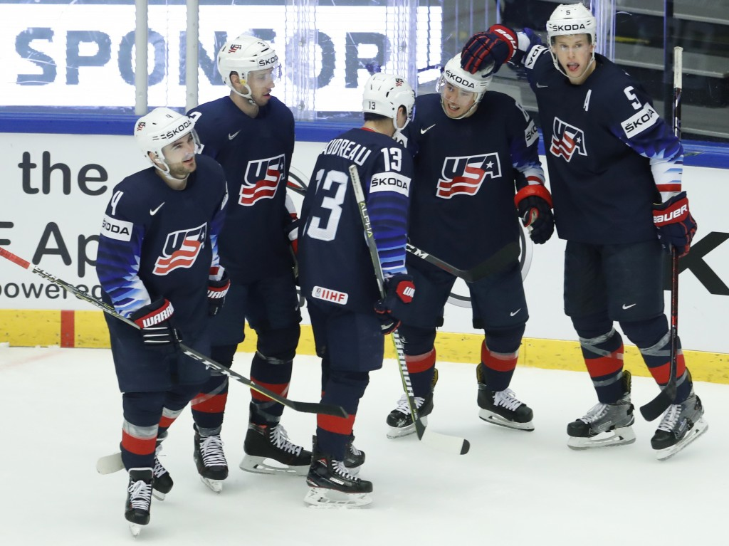 Cam Atkinson, 2nd right, of the United States celebrates with teammates after scoring his sides second goal during the Ice Hockey World Championships