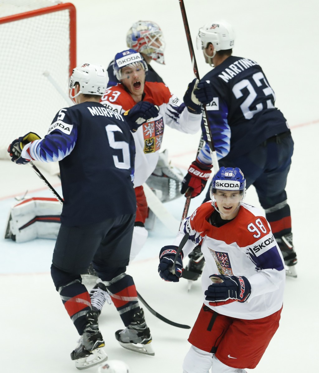 Czech Republic's Martin Necas, down, celebrates after scoring his sides second goal during the Ice Hockey World Championships quarterfinal match betwe
