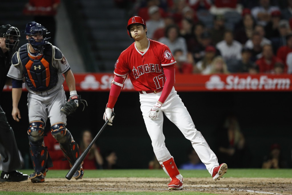 Los Angeles Angels' Shohei Ohtani, of Japan, reacts after striking out during the sixth inning of the team's baseball game against the Houston Astros ...