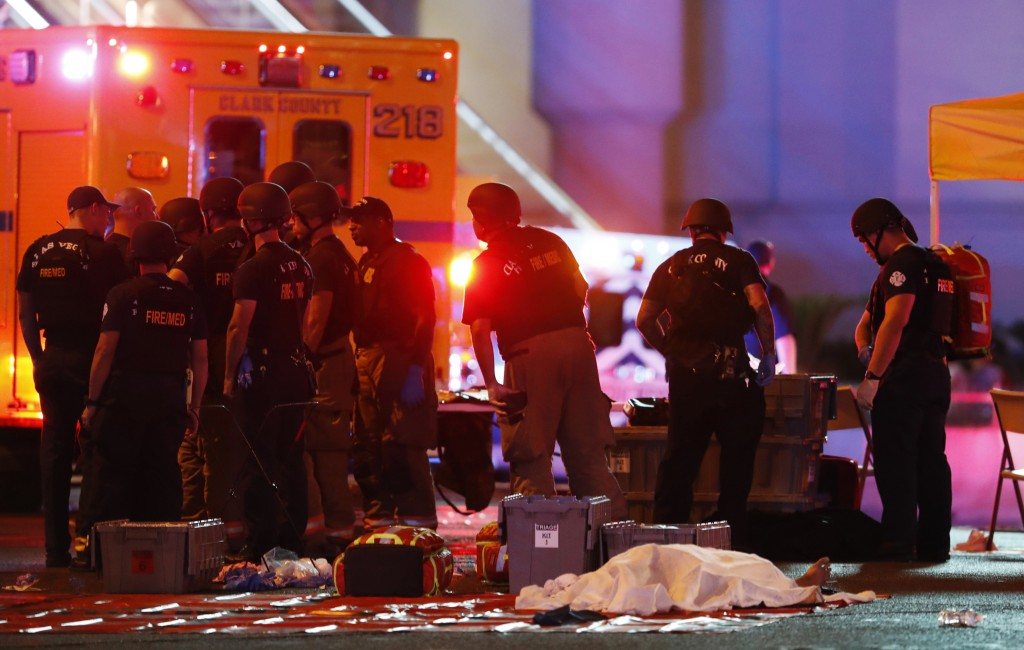 FILE - In this Oct. 1, 2017, file photo, a body is covered with a sheet after a mass shooting in which dozens were killed at a music festival on the L