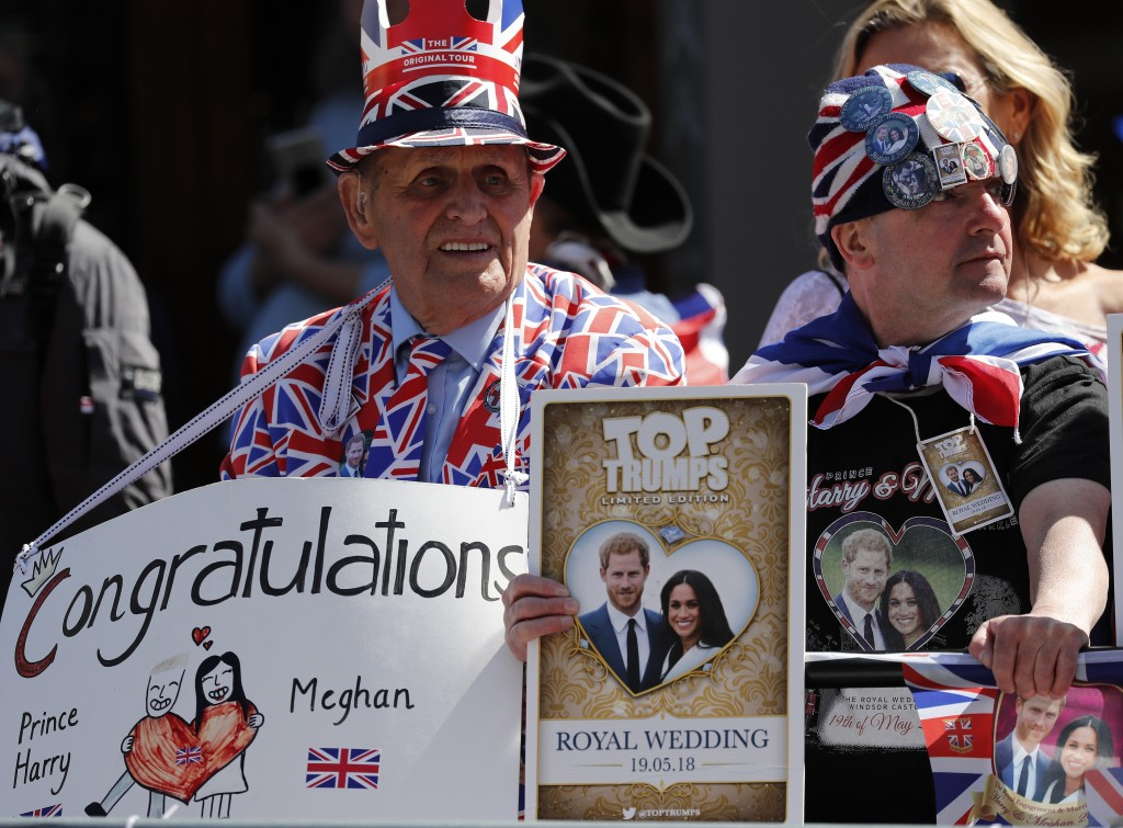 Royal fans wait to watch a rehearsal of the royal wedding in Windsor, England, Thursday, May 17, 2018. Preparations are being made in the town ahead o